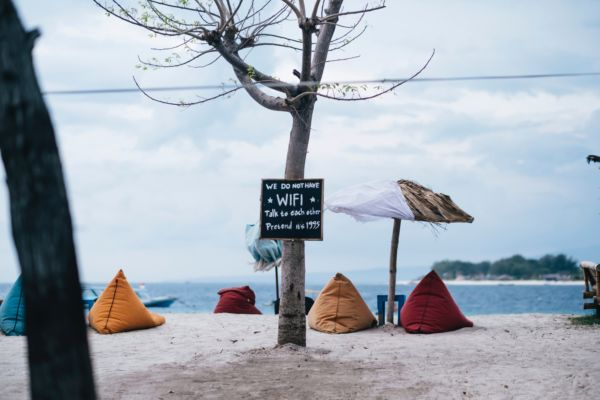 Photo of a beach in Indonesia with sign saying