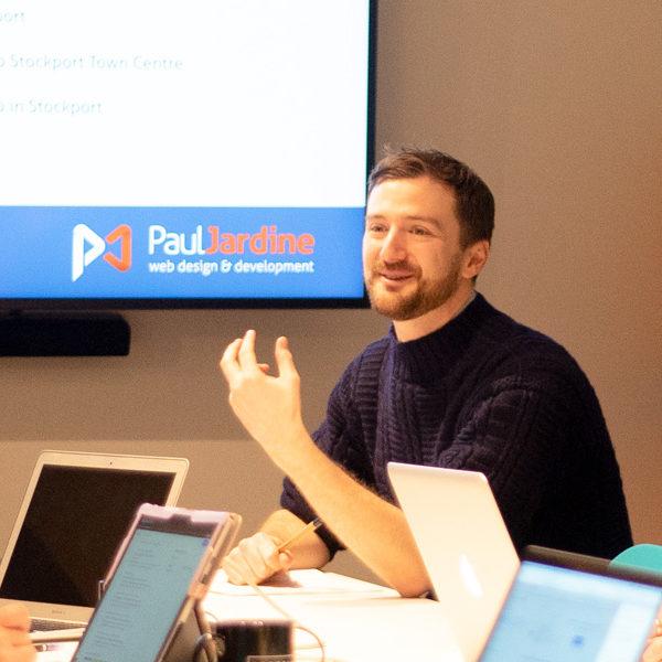 The web designer Paul Jardine presenting an SEO training workshop in Stockport.