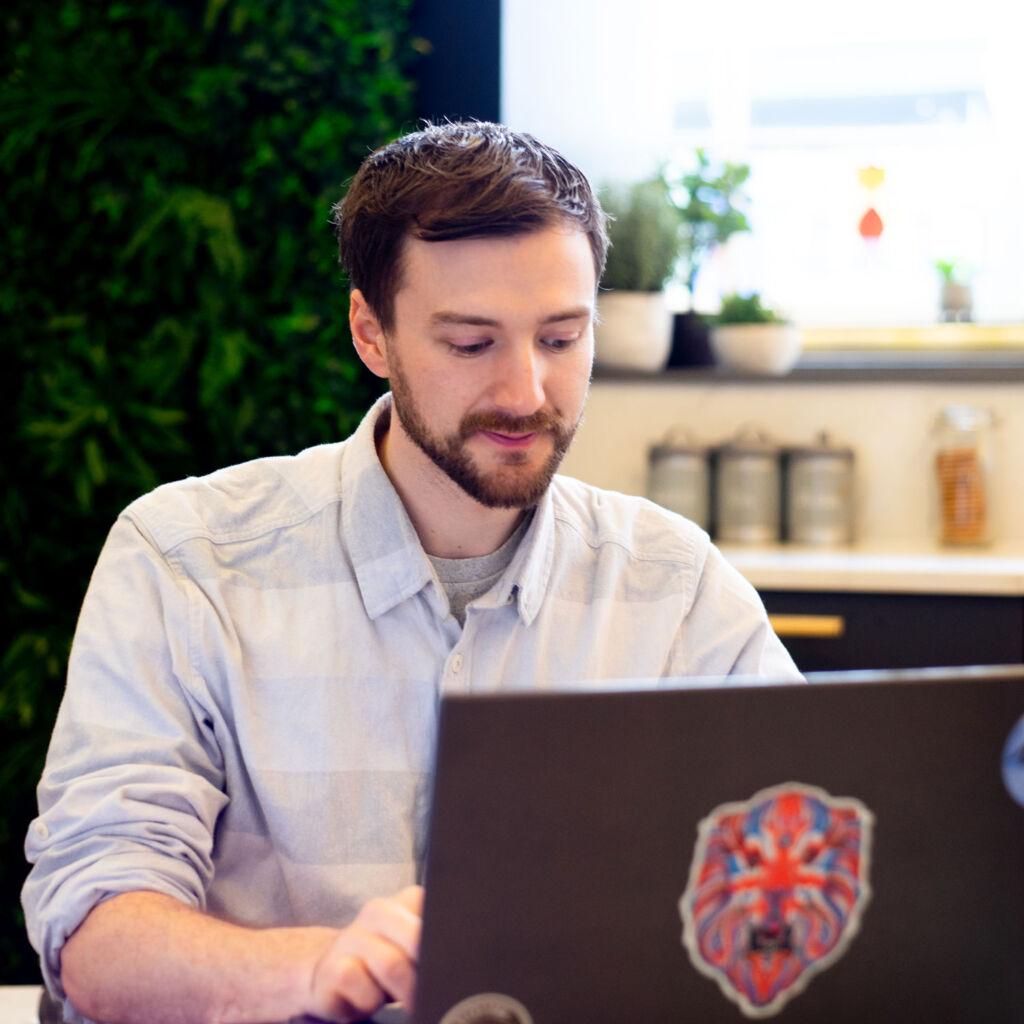 The Stockport web designer Paul Jardine sat working at his laptop.