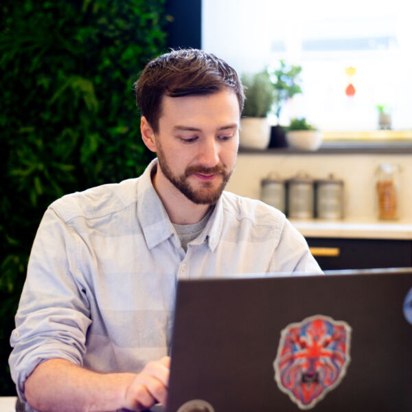 The web designer Paul Jardine working at his laptop.