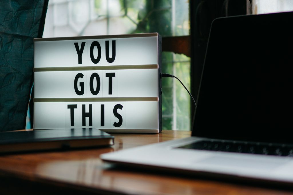 Sign on a desk that reads 'You got this'.